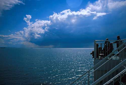 Methinks it is like a weasel - cloud watching from the English Channel near Le Havre France